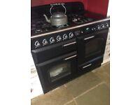 Range Master 110 Duel fuel cooker. 4 burners plus large wok burner and hot plate. 2 ovens, Sep grill