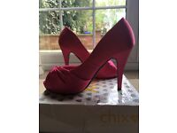 Pink size 5 high heels