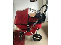 Red Bugaboo Chameleon with accessories. Originally bought for £1000.