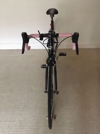 Road bike*practically new*selling as moving away! Includes lock, helmet, light and support for phone