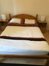 Double bed and spring/foam mattress with 2 matching bedside tables and lights