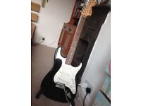Fender Squier Stratocaster with amp, lead and song book