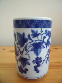 Ceramic blue & white pot/vase with grape & vine leaf design. Excellent condition.