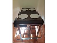 Stylish table and stools to seat 4 persons
