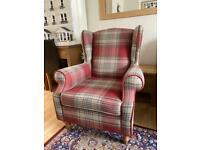 Tartan next Sherlock Holmes chair