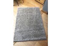 Medium sized oatmeal colour rug for sale