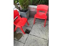 2 children's red plastic chairs