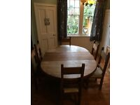 Solid wood extendable dining table with six chairs