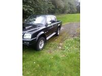 05 L200 crew cab excellent condition in and out full mot drives great may consider taking part X