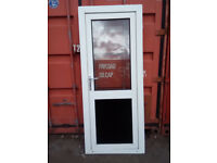 White upvc door with clear glass top panel, and blacked out lower,...