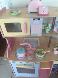 Wooden play kitchen and accessories.