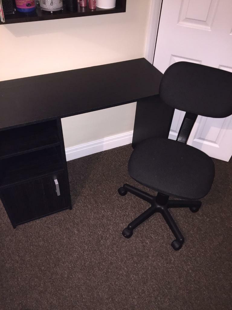 Black computer desk and swivel chair