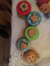 ELC wooden caterpillar shape sorter