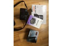 Canon 550D DSLR digital camera with zoom lens, battery grip and tripod