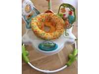 Jumperoo sunny days -fisher price. Rewards baby jumping with music, lights,sounds,360 swivel.
