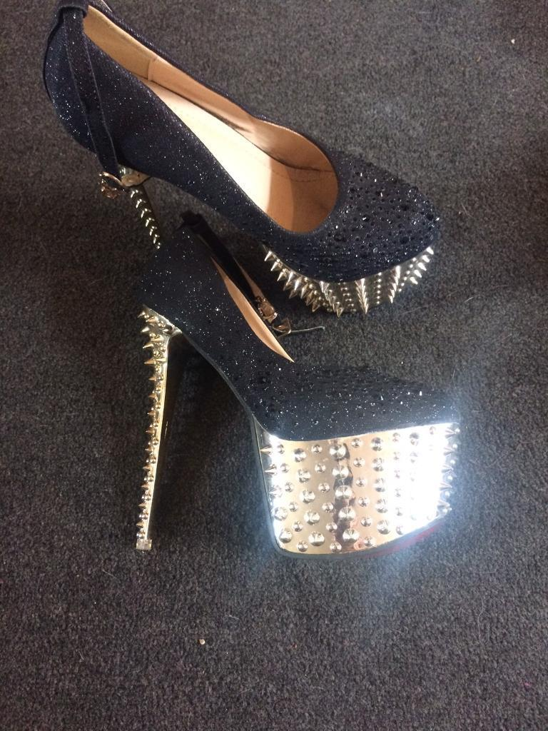 Extravagant spiked glittery skyscraper heelsin Middlesbrough, North YorkshireGumtree - Never been worn, immaculate condition, statement shoes, size 6, collection only paid 40 would like 15 but open to offers