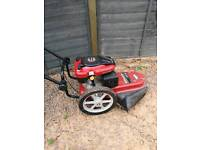 Wheeled strimmer and brush cutter