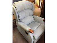 Green material recliner armchair