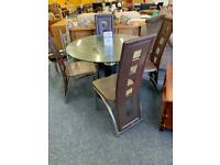 Round glass dining table 3 brown chairs