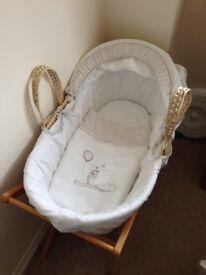 Moses basket from Mamas & Papas, with wooden stands.