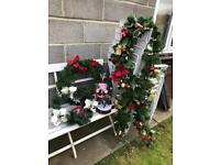 Musical moving Santa plus wreaths and fire place garlands.