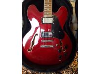 Gibson ES-335 copy, semi accustic, cheery red with black hard case. New condition minor chip see pic
