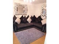 Grey and black corner fabric sofa. Excellent condotion