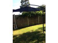 Tilting garden parasol