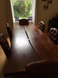 Unique acacia wood dining table and six leather chairs. Great condition.
