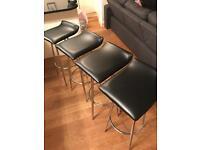 4 black swivel bar stools