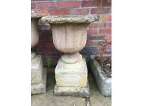 Set of old English stone urns and troughs