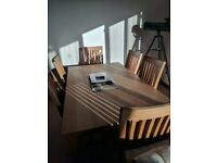 Light solid wood table & six chairs
