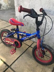 Huffy blue and red 12 inch bike with stabilisers
