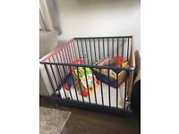Wooden, collapsible playpen.
