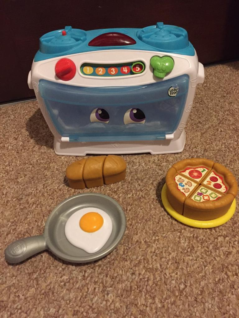 Leap frog toy oven. Pretend play pizza and food. Baby toddler children.