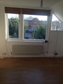 Studio flat on top floor of house