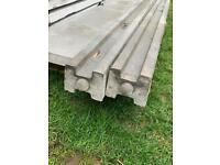 2 concrete fence posts
