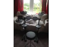 Yamaha DTX400 Electronic Drumkit with too, sticks and amp.