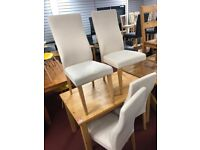 table and 4 cream fabric chairs