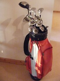 Set of MITSUSHIBA POWER CACHE SYSYEM Golf clubs in a lovely red, black and grey Hogan bag with hood