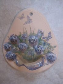 Wall mountable pottery ornament