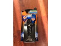 Gillette fusion new mens shaver with different heads