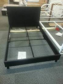 A brand black leatherette 3 quarter bed frame.