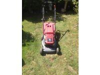 Mountfield self propelled petrol lawn mower.
