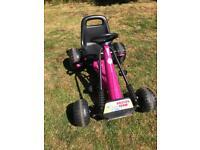 Girls peddle go cart
