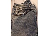 Size 10 H&M acid wash ripped skinny jeans