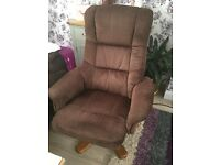 Swivel upholstered fabric chair with footstool