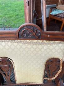 Two carved wooden armchairs