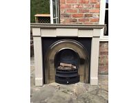 Gas fire polished cast arch fireplace and surround