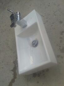 "BATHROOM WC UTILITY COMPACT SMALL SINK WITH BRASS CHROME TAPS IN GOOD CONDITION ,10"" X 20"" APPROX"